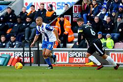 James Vaughan of Wigan Athletic takes on Harrison McGahey of Rochdale - Mandatory by-line: Robbie Stephenson/JMP - 24/02/2018 - FOOTBALL - DW Stadium - Wigan, England - Wigan Athletic v Rochdale - Sky Bet League One