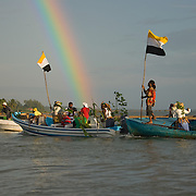 Boats coming into the North Stann Creek River as part of the Garifuna Yurumei re-enactment at Dangriga, Belize
