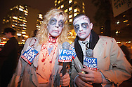 New York, NY, October 31, Jess Wood and Charlie Gaeta, political comedians, dress as fox reporters for the Occupy Wall Street movement's march in the Greenwich Village Annual Halloween Parade.