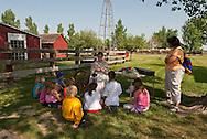 Big Horn County Historical Museum, school children, spinning demonstration, Hardin, Montana
