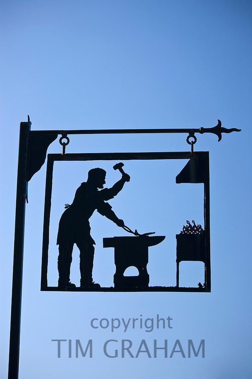Blacksmith's forge metal sign in Gloucestershire near Winchcombe