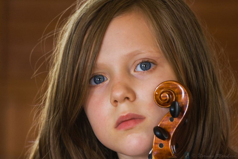 Young violinist attending a summer workshop series taking place with the support of the Andy Mackie Music Foundation