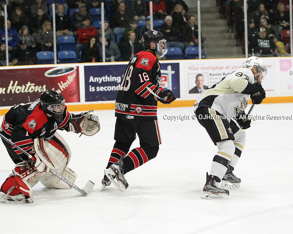 TRENTON, ON  - APR 15,  2017: Ontario Junior Hockey League, Championship Series. Georgetown Raiders vs the Trenton Golden Hawks in Game 2 of the Buckland Cup Final. Josh Astorino #1 follows the play as Matthew Thom #18 and Dawson Baker #9 battle for position during the second period.<br /> (Photo by Tim Bates / OJHL Images)