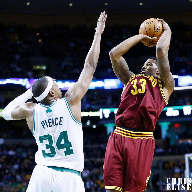 19 December 2012: Cleveland Cavaliers small forward Alonzo Gee (33) takes a jumpshot over Boston Celtics small forward Paul Pierce (34) during the Boston Celtics 103-91 victory over the Cleveland Cavaliers at the TD Garden, Boston, Massachusetts, USA.