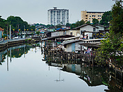 "22 MARCH 2018 - BANGKOK, THAILAND: Khlong Lat Phrao. Bangkok officials are evicting about 1,000 families who have set up homes along Khlong  Lat Phrao in Bangkok, the city says they are ""encroaching"" on the khlong. Although some of the families have been living along the khlong (Thai for ""canal"") for generations, they don't have title to the property, and the city considers them squatters. The city says the residents are being evicted so the city can build new embankments to control flooding. Most of the residents have agreed to leave, but negotiations over compensation are continuing for residents who can't afford to move.      PHOTO BY JACK KURTZ"