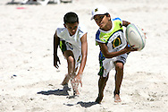 Camps Bay, A junior player slips the touch tackle during the Oasis SKW Camps Bay Beach Touch Rugby Tournament held on the 2 February 2008, Cape Town, South Africa...Image © Sportzpics