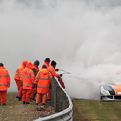 Race 1 - At the Avon Tyres British GT Championship held at Oulton Park, Cheshire, UK..The marshalls putting out the fire on the LNT, Richard Sykes & Mike Simpson, G55 Ginetta GT3, GT3.1st April 2013 WAYNE NEAL | STOCKPIX.EU