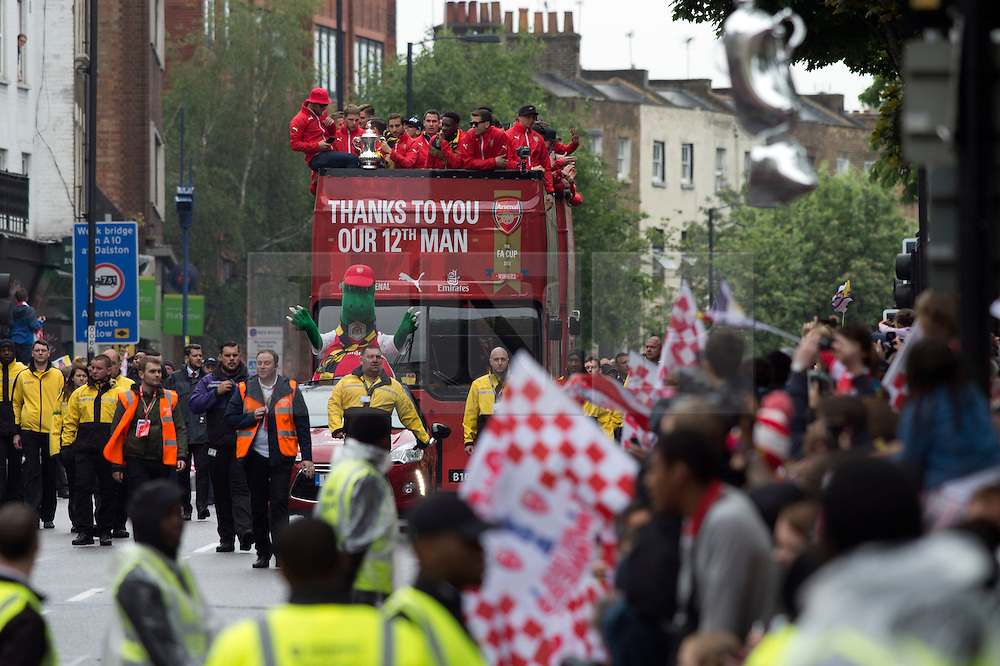 &copy; Licensed to London News Pictures. 31/05/2015. <br /> LONDON, UK. The Arsenal FC first team and manager Arsene Wenger parade the FA Cup trophy through the streets of North London in an open top bus to celebrate winning the FA Cup yesterday, London, Sunday 31 May 2015. Photo credit : Hannah McKay/LNP