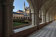 East gallery of the main Grand-Moutier Cloister at Fontevraud Abbey, Fontevraud-l'Abbaye, Loire Valley, Maine-et-Loire, France. The cloister, built to house virgin nuns, was originally Romanesque but was rebuilt in the 16th century. Renee de Bourbon renovated the south gallery in Gothic style in 1519, then Louise de Bourbon rebuilt the 3 other galleries in classical style 1530-60. The abbey was founded in 1100 by Robert of Arbrissel, who created the Order of Fontevraud. It was a double monastery for monks and nuns, run by an abbess. The abbey is listed as a historic monument and a UNESCO World Heritage Site. Picture by Manuel Cohen