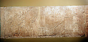 Ashurbanipal II, King of Assyria 833-859 BC, leading assault on city with battering rams and siege engines. Bas-relief. British Museum