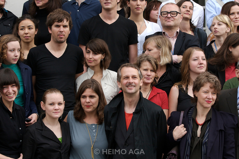 documenta12. Official photo op of documenta staff at Fridericianum. Artistic Director Roger M. Buergel (red t-shirt), Curator Ruth Noack (r. of him).
