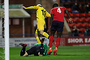 Chester striker Anthony Dudley (10) puts the pressure on York City goalkeeper Adam Bartlett (1) during the Vanarama National League match between York City and Chester FC at Bootham Crescent, York, England on 13 November 2018.
