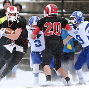 Alexander LaPolice, New Canaan, on his way to a touchdown during the New Canaan Rams Vs Darien Blue Wave, CIAC Football Championship Class L Final at Boyle Stadium, Stamford. The New Canaan Rams won the match in snowy conditions 44-12. Stamford,  Connecticut, USA. 14th December 2013. Photo Tim Clayton