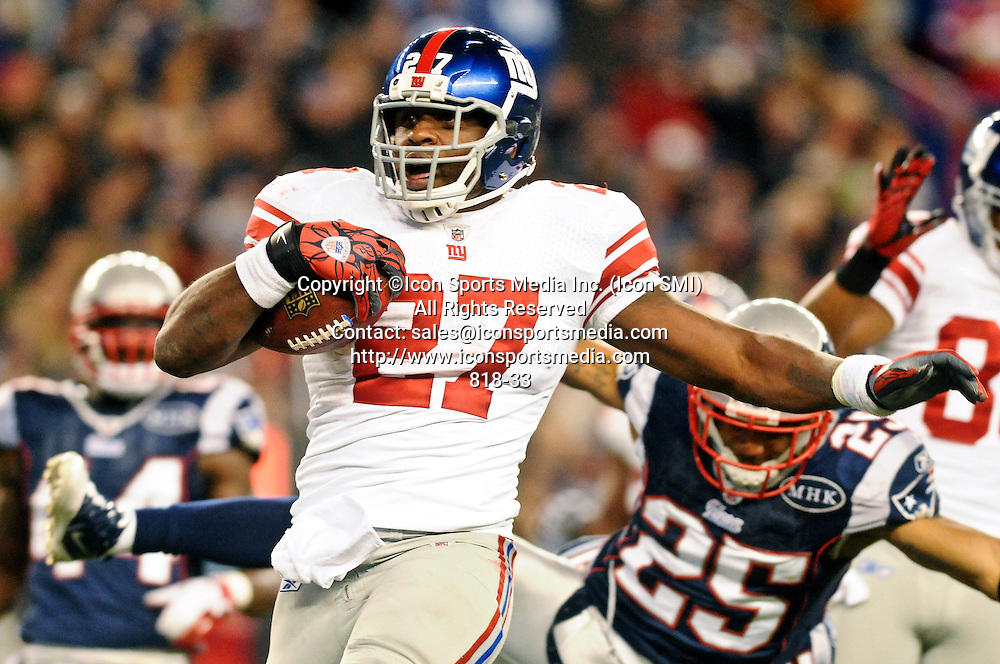 Nov. 6, 2011 - Foxborough, Massachusetts, U.S - New York Giants RB Brandon Jacobs (27) sprints past the tackles of the New England Patriots on his way to a touchdown early in the second half. The New York Giants defeat the New England Patriots 24- 20 in the last seconds at Gillette Stadium