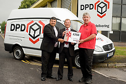 DPD Owner Driver Franchisee John Mallon (right)  receives a gift voucher for £250 from Regional Manager Steve Church and Depot Manager Andy Markham (left) at the DPD distribution centre  at Thorncliffe Chapeltown Sheffield 14  July 2010 .Images © Paul David Drabble.