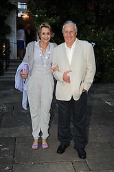 FREDERICK & SANDY FORSYTH leaving a summer party hosted by Lady Annabel Goldsmith at her home Ormeley Lodge, Ham Gate, Richmond on 13th July 2010.