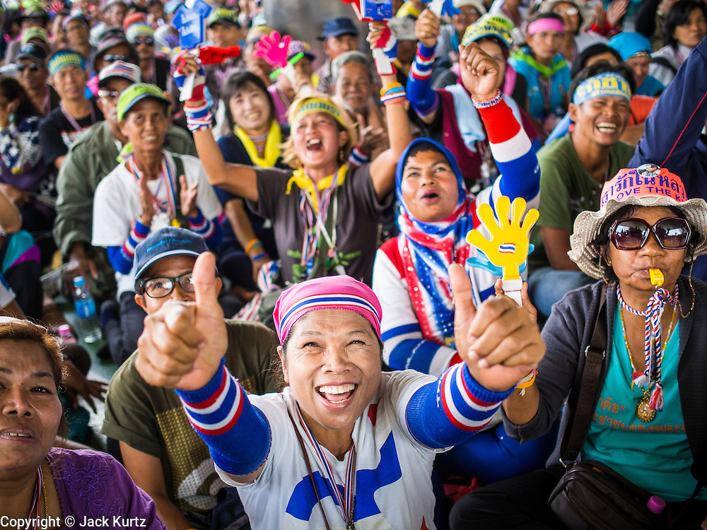"08 APRIL 2014 - BANGKOK, THAILAND: Anti-government protestors block the entrance to the Ministry of Justice in Bangkok. Several hundred anti-government protestors led by Suthep Thaugsuban went to the Ministry of Justice in Bangkok Tuesday. Suthep and the protestors met with representatives of the Ministry of Justice and expressed their belief that Thai politics need to be reformed and that corruption needed to be ""seriously tackled."" The protestors returned to their main protest site in Lumpini Park in central Bangkok after the meeting.    PHOTO BY JACK KURTZ"
