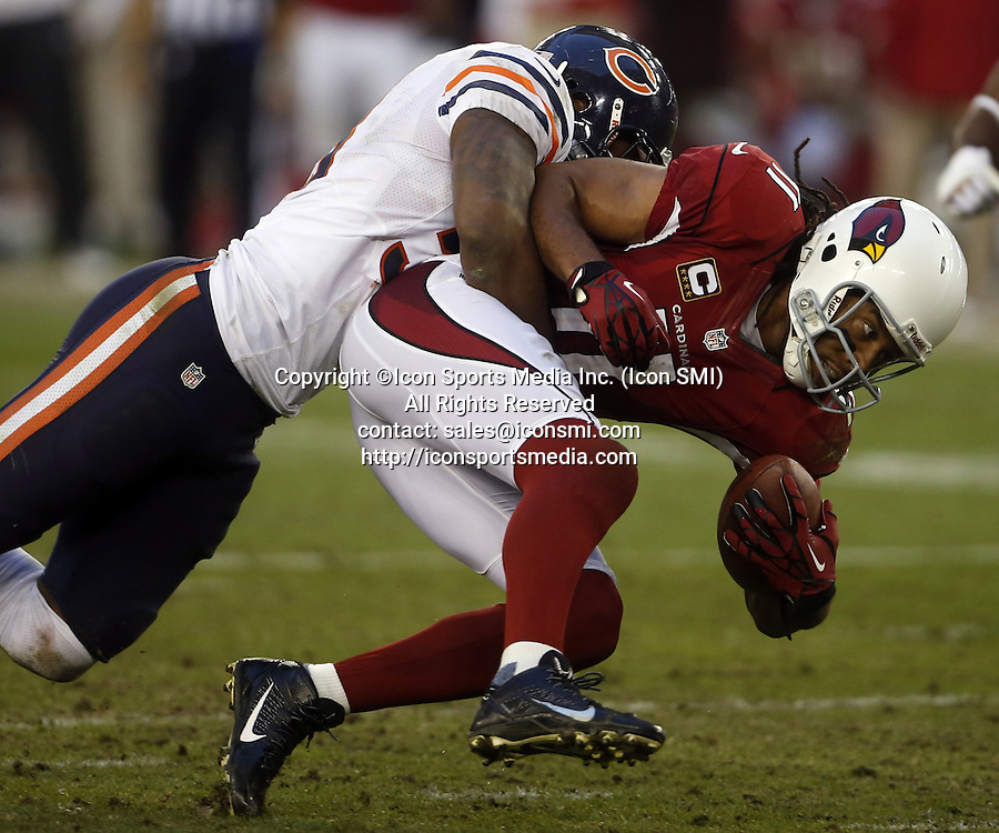 Dec. 23, 2012 - Phoenix, AZ, USA - Chicago Bears outside linebacker Nick Roach (53) tackles Arizona Cardinals wide receiver Larry Fitzgerald (11) in the fourth quarter at University of Phoenix Stadium on Sunday, December 23, 2012, in Phoenix, Arizona. The Chicago Bears defeated the Arizona Cardinals, 28-13.