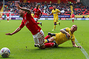 Ricky Holmes of Charlton Athletic is brought down just outside the box by Barry Fuller (captain) of AFC Wimbledon during the EFL Sky Bet League 1 match between Charlton Athletic and AFC Wimbledon at The Valley, London, England on 28 October 2017. Photo by Toyin Oshodi.