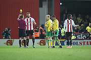 Brentford defender Harlee Dean (6) yellow card during the EFL Sky Bet Championship match between Brentford and Norwich City at Griffin Park, London, England on 31 December 2016. Photo by Matthew Redman.