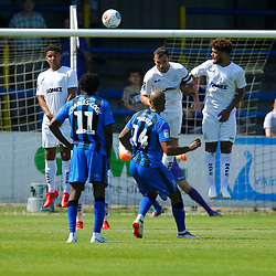 Gillingham's Josh Parker curls the ball around a Dover wall during the pre-season friendly match between Dover Athletic and Gillingham FC at Crabble Stadium, Kent on 21 July 2018. Gillingham ran out 3 to nothing winners. Photo by Matt Bristow.