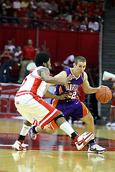 12 January 2008: Dom Johnson greets Jason Holsinger at half court during a game in which  the Purple Aces of the University of Evansville lost to  the Redbirds of Illinois State on Doug Collins Court at Redbird Arena in Normal Illinois by a score of 74-66.