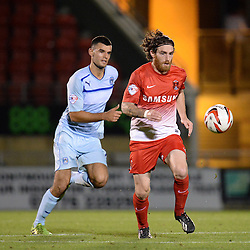 Leyton Orient's Romain Vincelot runs with the ball - Photo mandatory by-line: Mitchell Gunn/JMP - Tel: Mobile: 07966 386802 08/10/2013 - SPORT - FOOTBALL - Brisbane Road - Leyton - Leyton Orient V Coventry City - Johnstone Paint Trophy