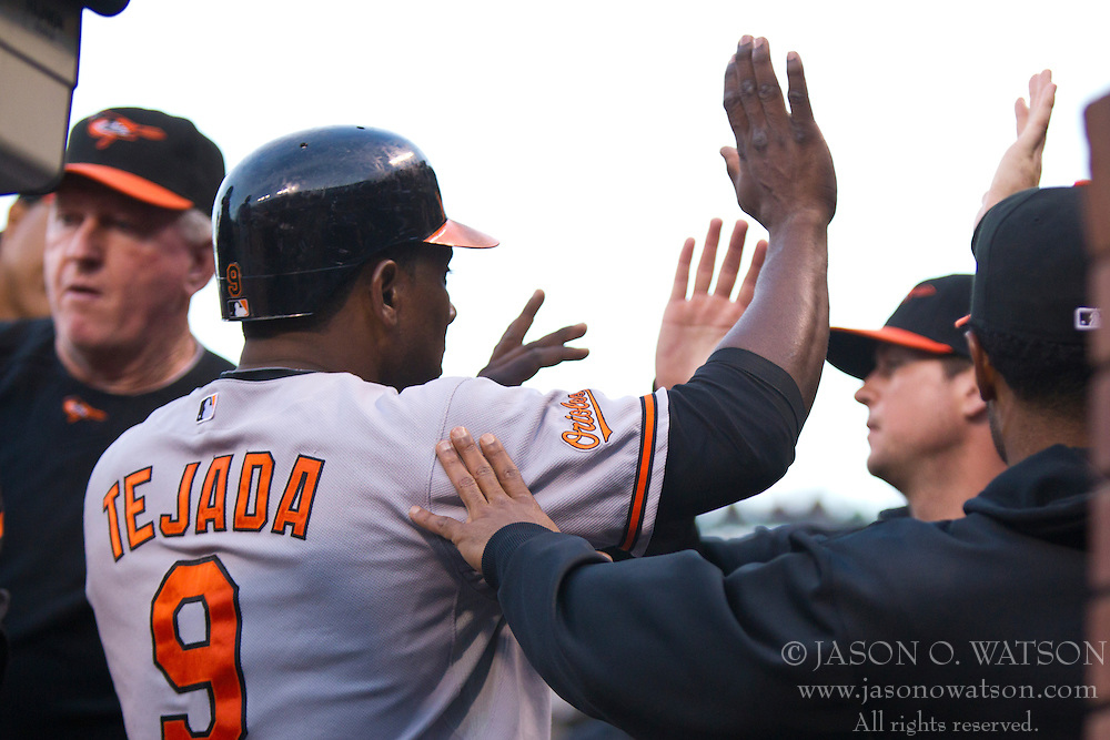 June 15, 2010; San Francisco, CA, USA;  Baltimore Orioles third baseman Miguel Tejada (9) celebrates with teammates after scoring a run against the San Francisco Giants during the third inning at AT&T Park.