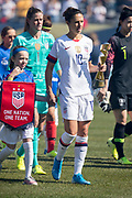 USA forward Carli Lloyd (10) walks onto the field with the World Cup Trophy before an international friendly against South Korea in Chicago, Sunday, Oct. 6, 2019, in Chicago. USWNT tied the Korea Republic 1-1. (Max Siker/Image of Sport)