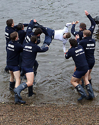 LNP HIGHLIGHTS OF THE WEEK 11/04/14 © Licenced to London News Pictures. 06/04/2014. London. UK.  <br /> Oxford University Blue boat are seen throwing their cox Laurence Harvey into the River Thames to celebrate their victory over Cambridge University in the annual BNY Mellon Boat Race between the two crews in London, April 6th, 2014. Oxford beat Cambridge.<br /> Photo Credit: Susannah Ireland