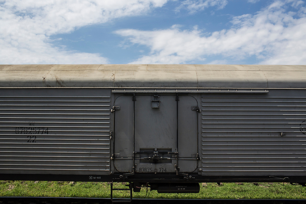 TOREZ, UKRAINE - JULY 20: A refrigerated train car holding the bodies of passengers from Malaysia Airlines flight MH17 waits at the train station for transport to an unknown location on July 20, 2014 in Torez, Ukraine. Malaysia Airlines flight MH17 was travelling from Amsterdam to Kuala Lumpur when it crashed killing all 298 on board including 80 children. The aircraft was allegedly shot down by a missile and investigations continue over the perpetrators of the attack. (Photo by Brendan Hoffman/Getty Images) *** Local Caption ***