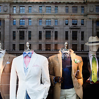 Reflections on a boutique shop window, Regent street, Westminster, London, England, United Kingdom