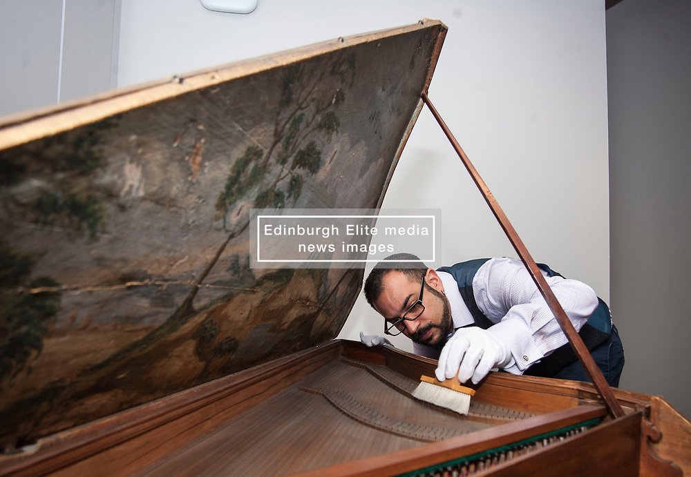 Conservator Jonathan Santa Maria Bouquet works on an ornate18th century harpsicord as part of the newly-refurbished St Cecilia's Hall, which has just undergone a 2 year, £6.5 million refurbishment which will see more of the University of Edinburgh's musical instrument collection on display to the public.<br /> <br /> © Dave Johnston/ EEm