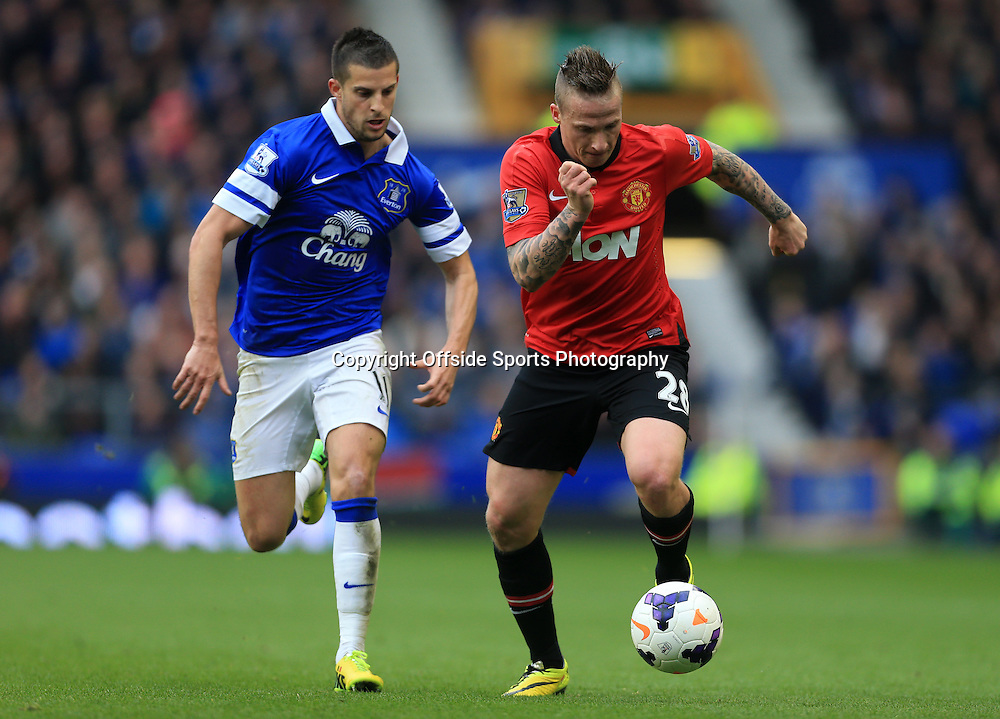 20th April 2014 - Barclays Premier League - Everton v Manchester United - Alexander Buttner of Man Utd battles with Kevin Mirallas of Everton - Photo: Simon Stacpoole / Offside.