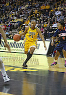 February 24 2011: Iowa Hawkeyes guard Kachine Alexander (21) drives with the ball during the first half of an NCAA women's college basketball game at Carver-Hawkeye Arena in Iowa City, Iowa on February 24, 2011. Iowa defeated Illinois 83-64.