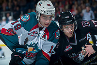 KELOWNA, CANADA - FEBRUARY 14:  Dillon Dube #19 of the Kelowna Rockets checks Reese Johnson #17 of the Red Deer Rebels after the face off on February 14, 2018 at Prospera Place in Kelowna, British Columbia, Canada.  (Photo by Marissa Baecker/Shoot the Breeze)  *** Local Caption ***