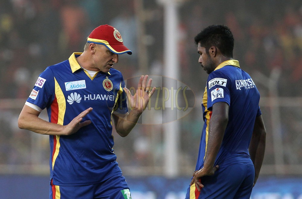 Royal Challengers Bangalore bowling coach Allan Donald speaks with Royal Challengers Bangalore player Varun Aaron before the start of the match 22 of the Pepsi IPL 2015 (Indian Premier League) between The Rajasthan Royals and The Royal Challengers Bangalore held at the Sardar Patel Stadium in Ahmedabad , India on the 24th April 2015.<br /> <br /> Photo by:  Vipin Pawar / SPORTZPICS / IPL