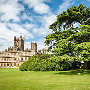 Highclere Castle, Hampshire. Highclere Castle, in Hampshire, is the home of the Earl and Countess of Carnarvon and is used in the filming of the British TV series Downton Abbey, created by Julian Fellowes.