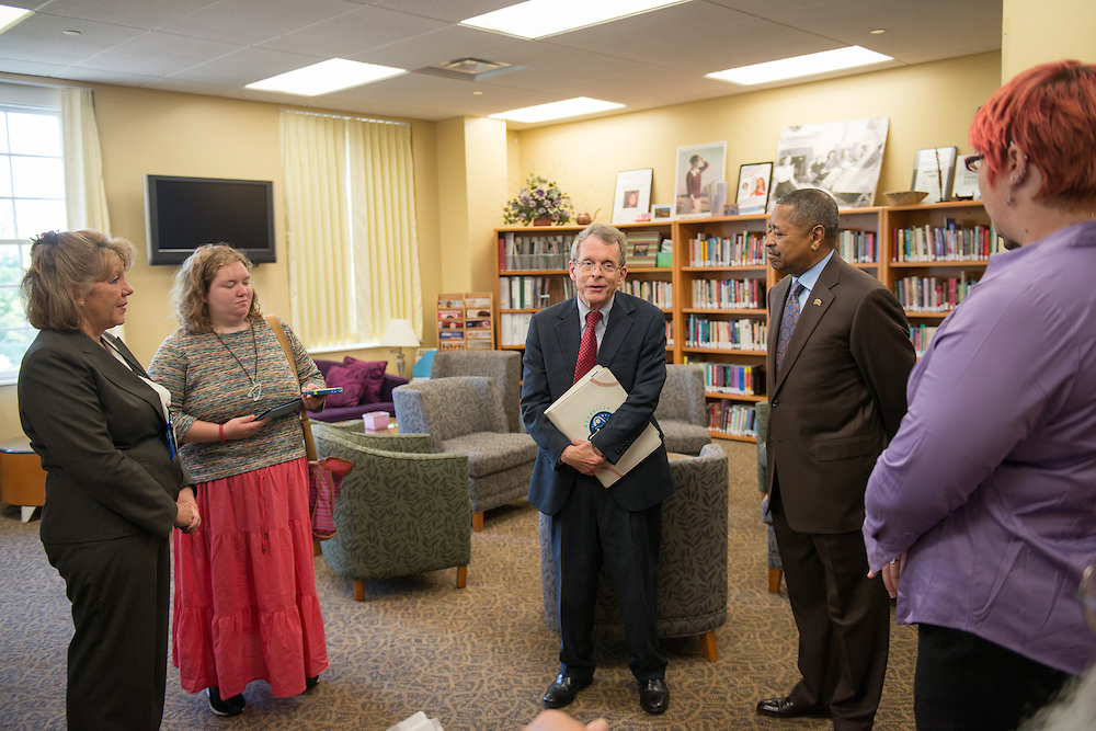 Ohio Attorney General Mike DeWine (Center) disucusses the achievements of Ohio University's sexual assault survivor advocacy program at Ohio University's Women's Center. Photo by Ben Siegel/ Ohio University.
