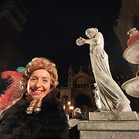 Official opening of 2012 Venice Carnival and Members of the association 'Amici del Carnevale di Venezia' wearing 18th century costumes enjoy live music and wine from the wine fountain in St Mark Square