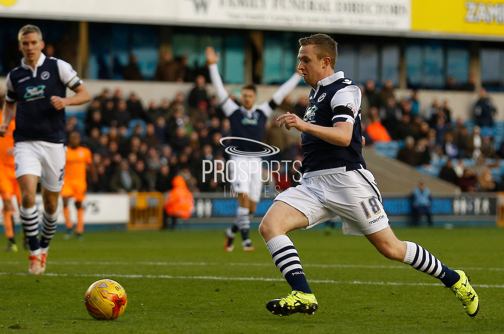 Millwall FC Midfielder Shane Ferguson tests himself to score Millwall's second during the Sky Bet League 1 match between Millwall and Colchester United at The Den, London, England on 21 November 2015. Photo by Andy Walter.