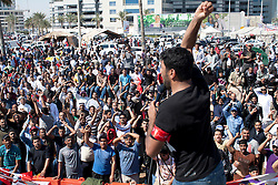 © under license to London News Pictures. 20/02/2011. Demonstrators join with Teachers to march around the Pearl Roundabout in Manama, Bahrain today (20/02/2011) in protest to teh Bahraini Royal Family's rule. Photo credit should read Michael Graae/London News Pictures