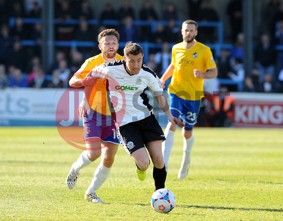 Bristol Rovers' Matty Taylor challenges Dover Athletic's Chris Kinnear - Photo mandatory by-line: Neil Brookman/JMP - Mobile: 07966 386802 - 18/04/2015 - SPORT - Football - Dover - Crabble Athletic Ground - Dover Athletic v Bristol Rovers - Vanarama Football Conference