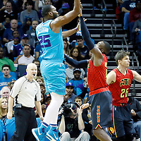 01 November 2015: Charlotte Hornets center Al Jefferson (25) goes for the jump shot over Atlanta Hawks forward Paul Millsap (4) during the Atlanta Hawks 94-92 victory over the Charlotte Hornets, at the Time Warner Cable Arena, in Charlotte, North Carolina, USA.