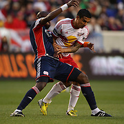 Tim Cahill, (right), New York Red Bulls, clashes with Kalifa Cisse, New England Revolution, during the New York Red Bulls V New England Revolution, Major League Soccer regular season match at Red Bull Arena, Harrison, New Jersey. USA. 20th April 2013. Photo Tim Clayton