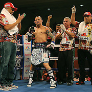 """Orlando """"El Fenomeno""""  Cruz is seen in his corner during introductions prior to his match against Gabino """"Flash"""" Cota during their Boxeo Telemundo WBO/NABO Super Featherweight bout on Friday, October 9, 2015 at the Kissimmee Civic Center in Kissimmee, Florida. Cruz, who is from Puerto Rico, is the first ever openly gay boxer  in the history of the sport and won the bout by unanimous decision.  (Alex Menendez via AP)"""