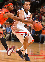 Virginia guard Calvin Baker (4) is guarded by Virginia Tech guard Malcolm Delaney (23).  The Virginia Cavaliers defeated the Virginia Tech Hokies 75-61 at the John Paul Jones Arena on the Grounds of the University of Virginia in Charlottesville, VA on February 18, 2009.