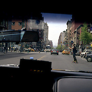 With space at a premium in the vast metropolis of Manhattan, New York City, locals find ways and means for pastime exercise and recreational activities as they go about their daily lives..A skateboarder on the road in Chelsea shot from a New York cab o May 3, 2004. Photo Tim Clayton.