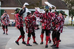 Runnymede, UK. 1st May, 2019. Datchet Border Morris provide a display of traditional morris dancing at sunrise on May Day. An all male Border Morris side with a mixed band, Datchet Border Morris have been dancing on the same site on May Day for 25 years.