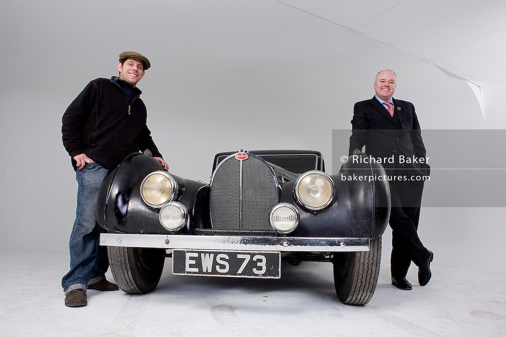 Found in a garage where it had been stored virtually untouched for 50 years, this 1937 Bugatti Type 57s Atalante sports car is previewd for the first time before a Bonhams auction in Paris on February 7th 2009. Phoenix Green Garage Studio owner and vintage car restorer Nick Benwell (L) with auctioneers Bonhams International Managing Director Motor car Department, James Knight.